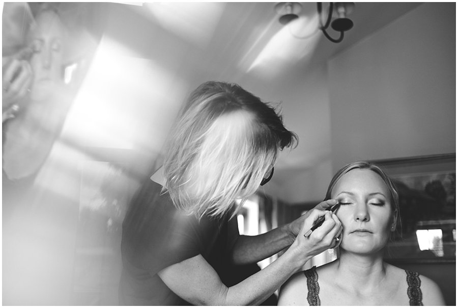 bride having make up applied by Lorraine Milligan