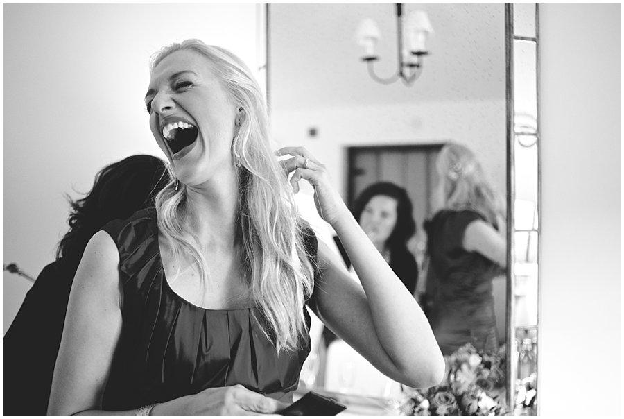bridesmaid laughing at wedding at Gate Street Barn