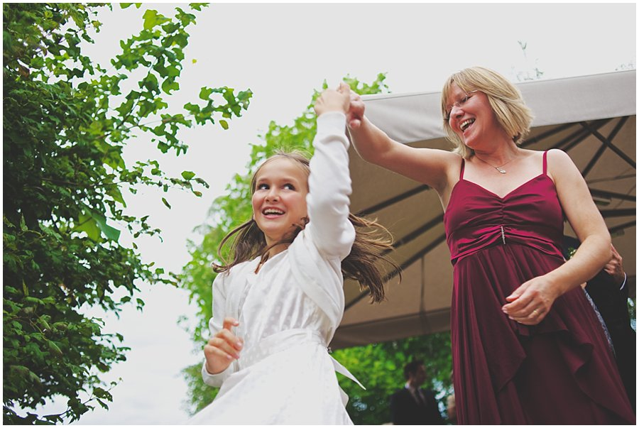 girl dancing with her mother at a wedding