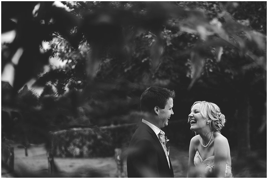 Bride and groom laughing at Gate Street Barn