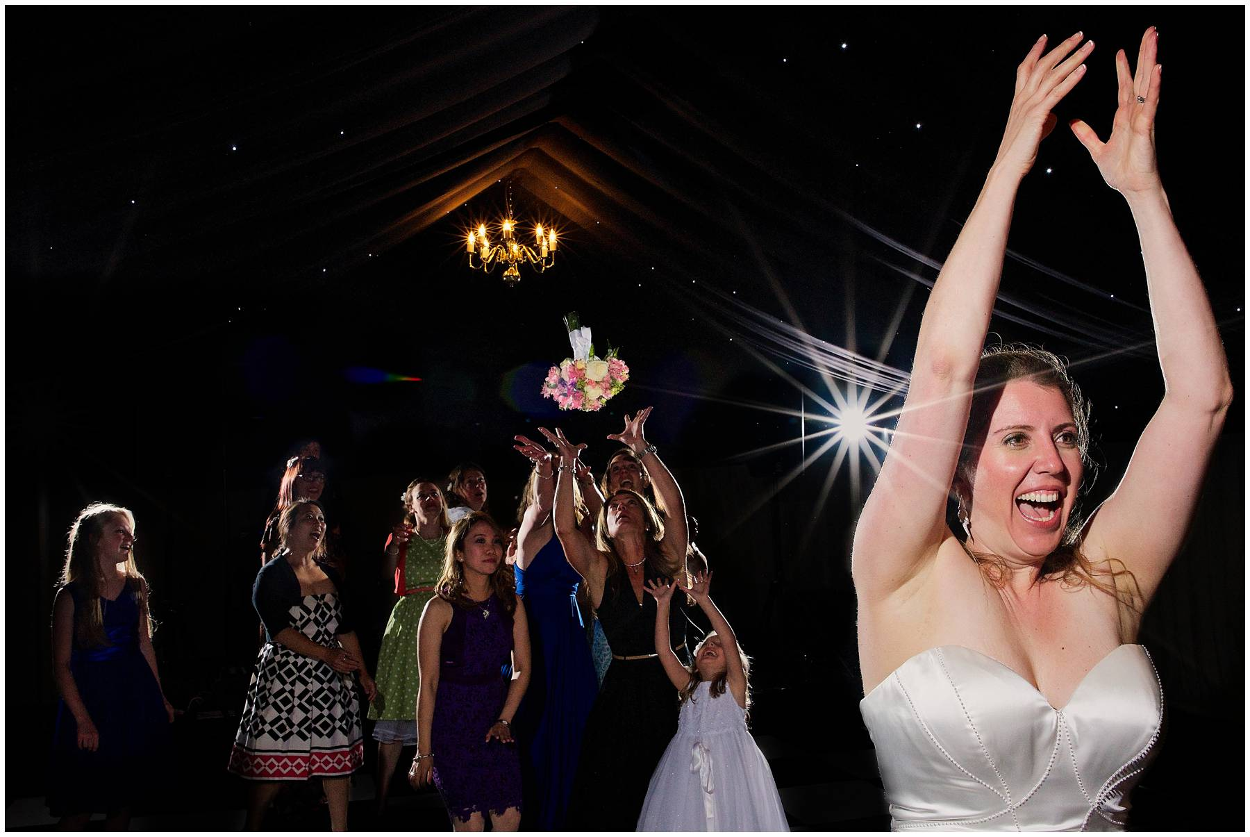 Bouquet toss at Stoneleigh Abbey Wedding