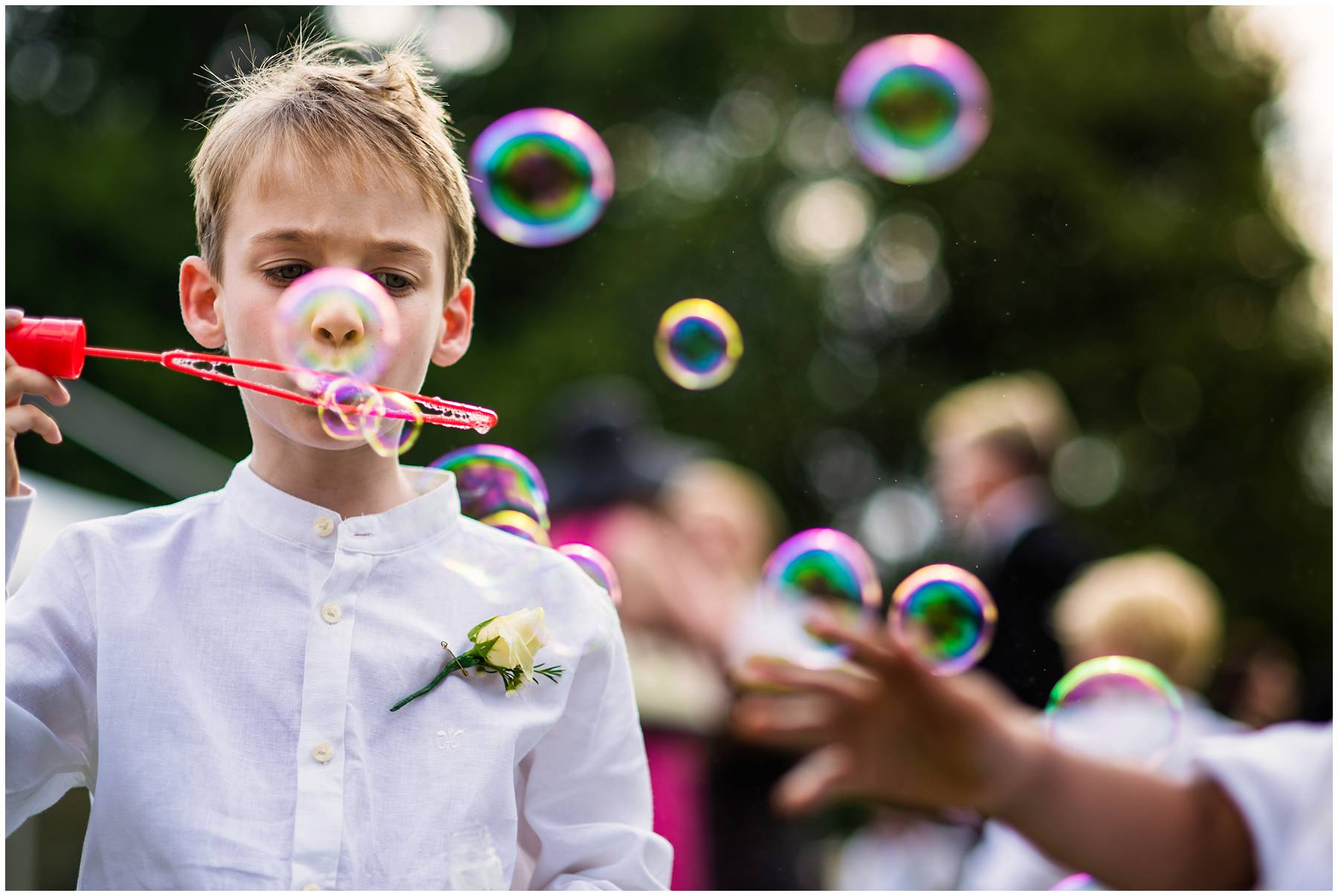 kids playing with bubbles at Suffolk marquee wedding