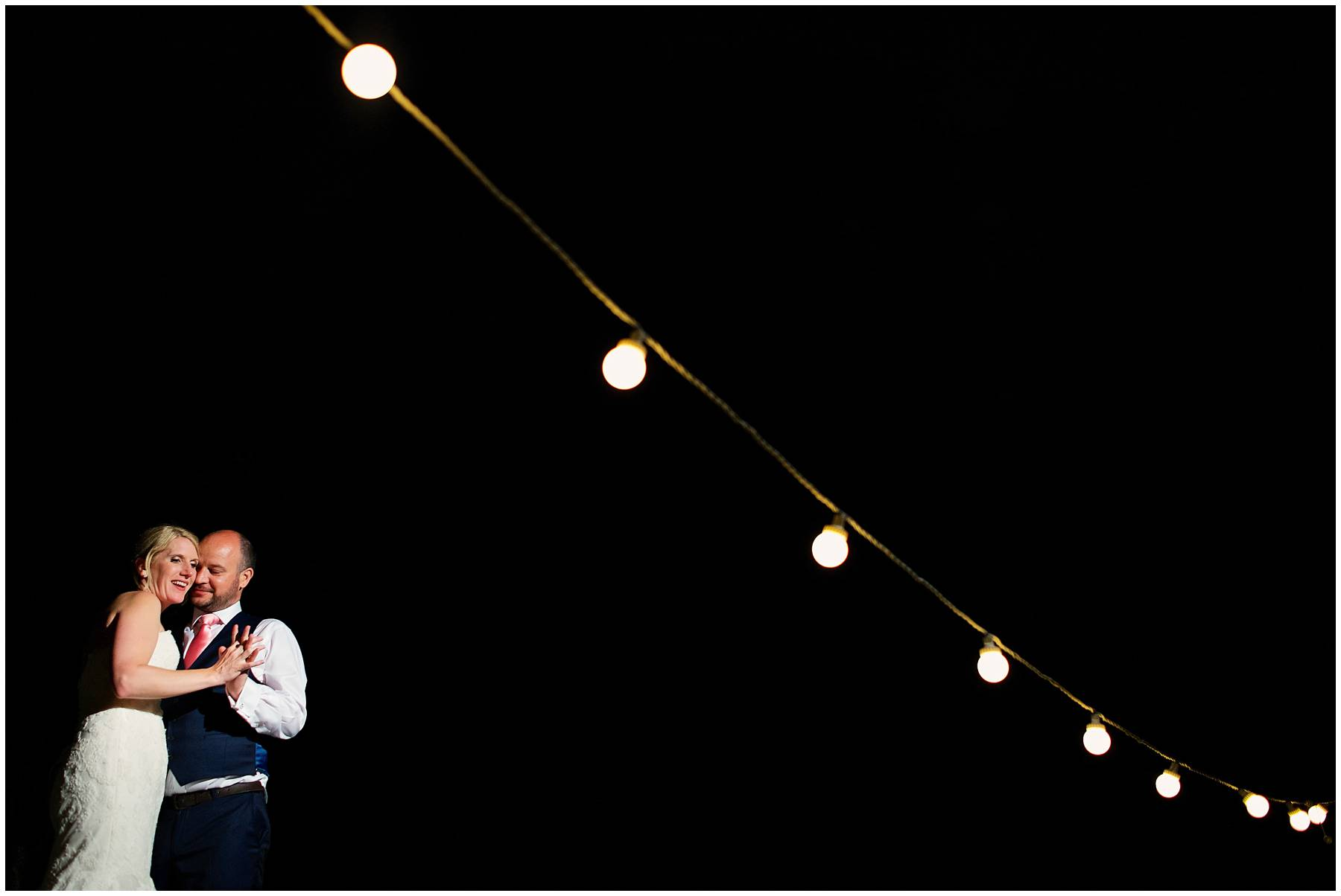 Festoon lights portrait at Somerset Wedding