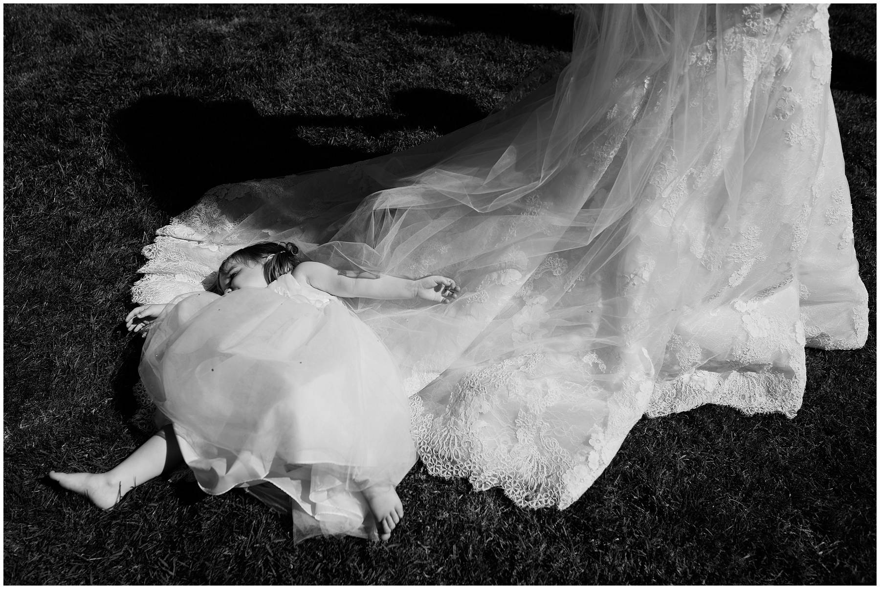 Cute kid lying on mum's wedding dress
