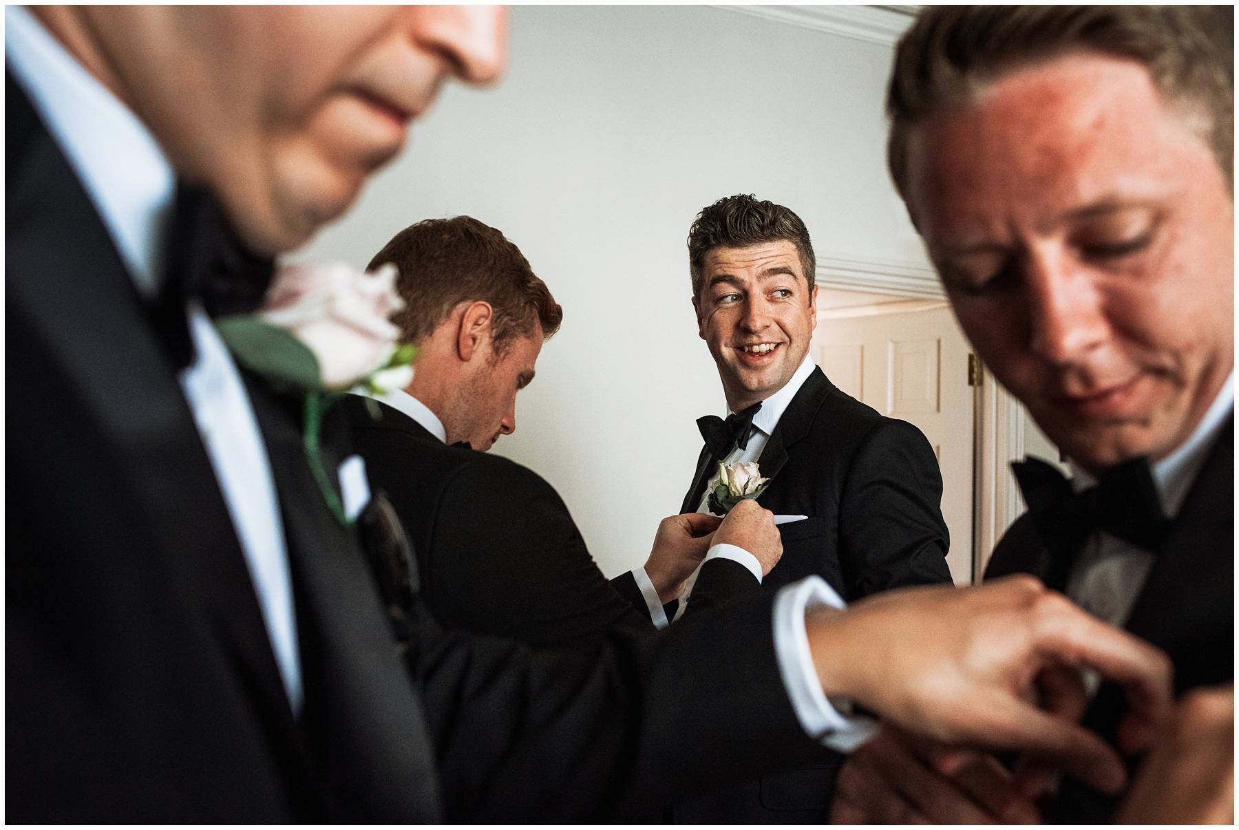 groom getting ready for wedding at Blenheim Palace