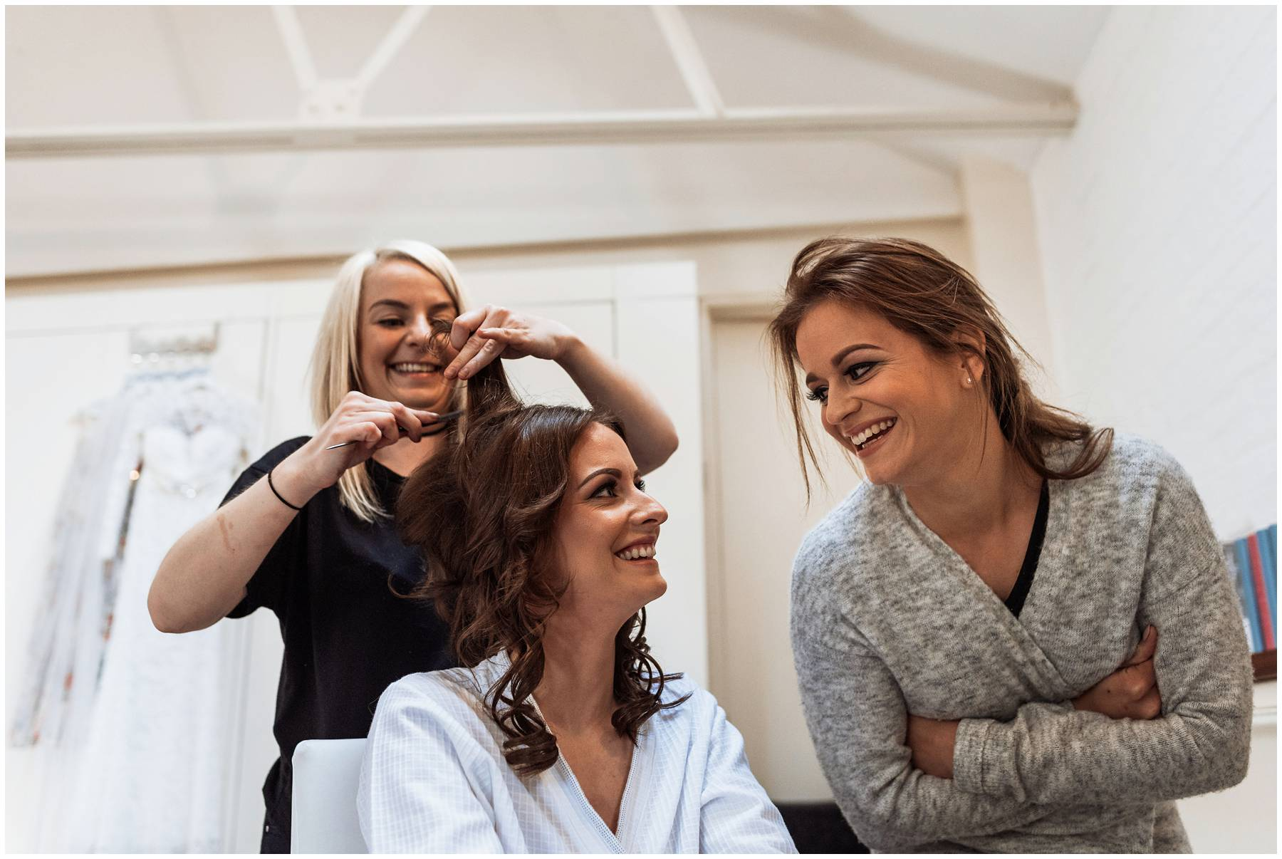 Bride and her sister laughing during bridal prep