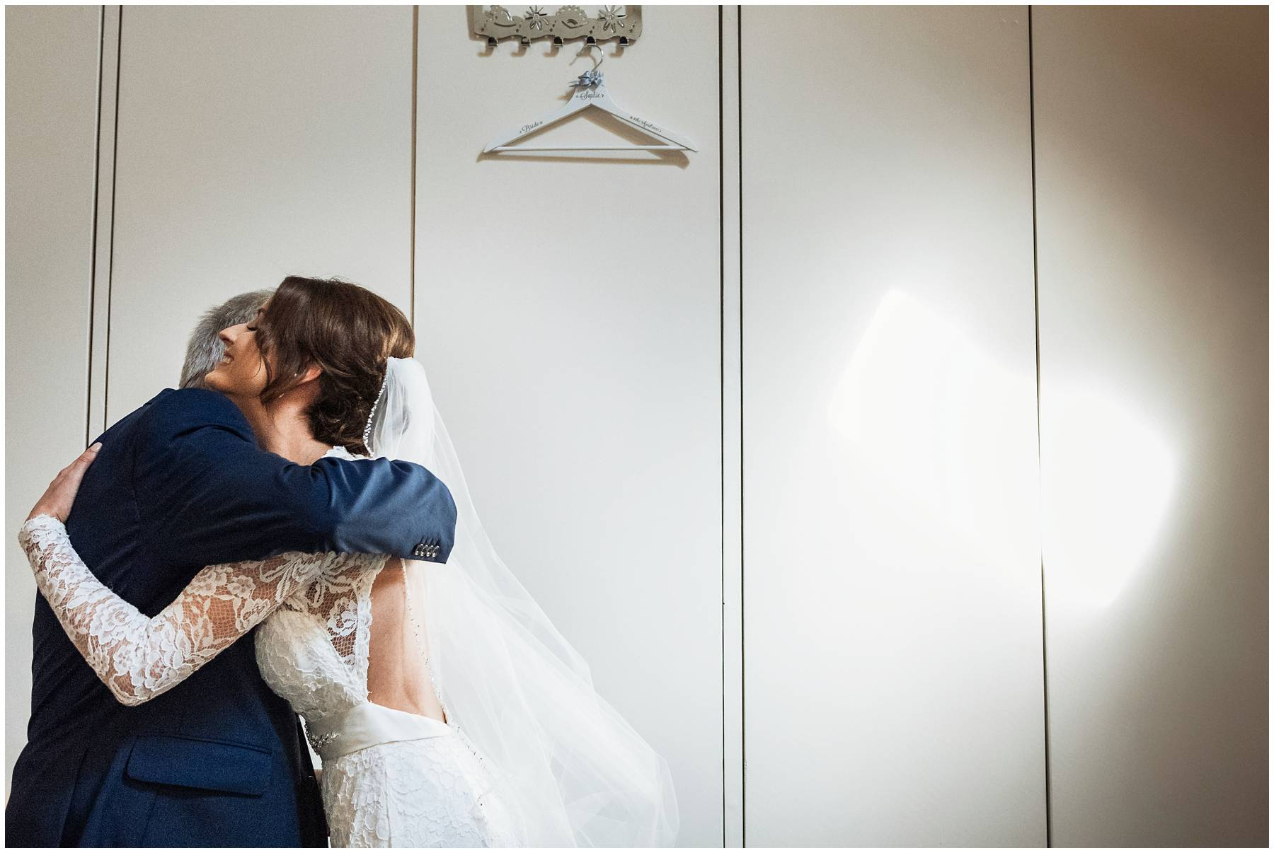 Bride and her father hugging before wedding