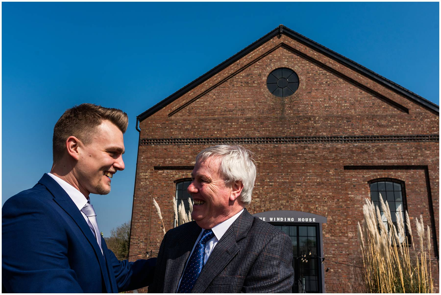 Groom greeting guests at the Winding House