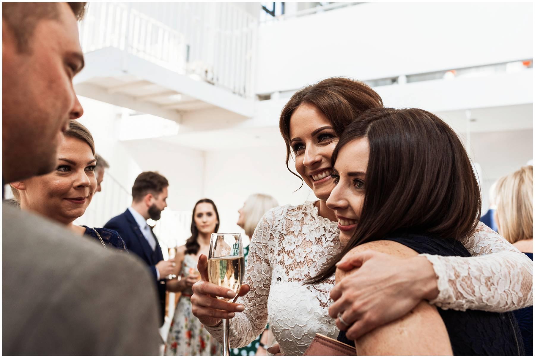 Bride hugging guests at Kent Wedding