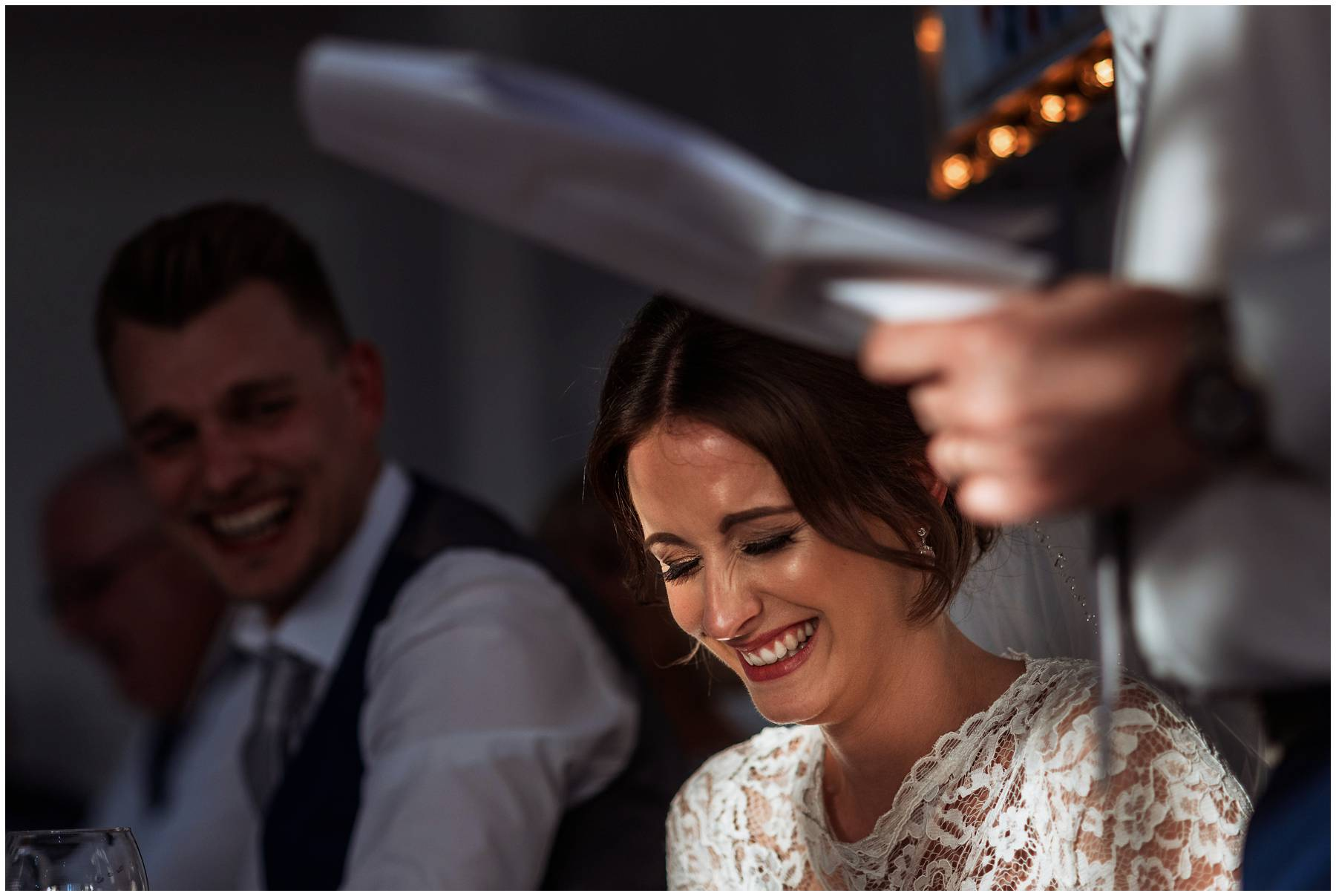 Bride laughing at her Dad's speech