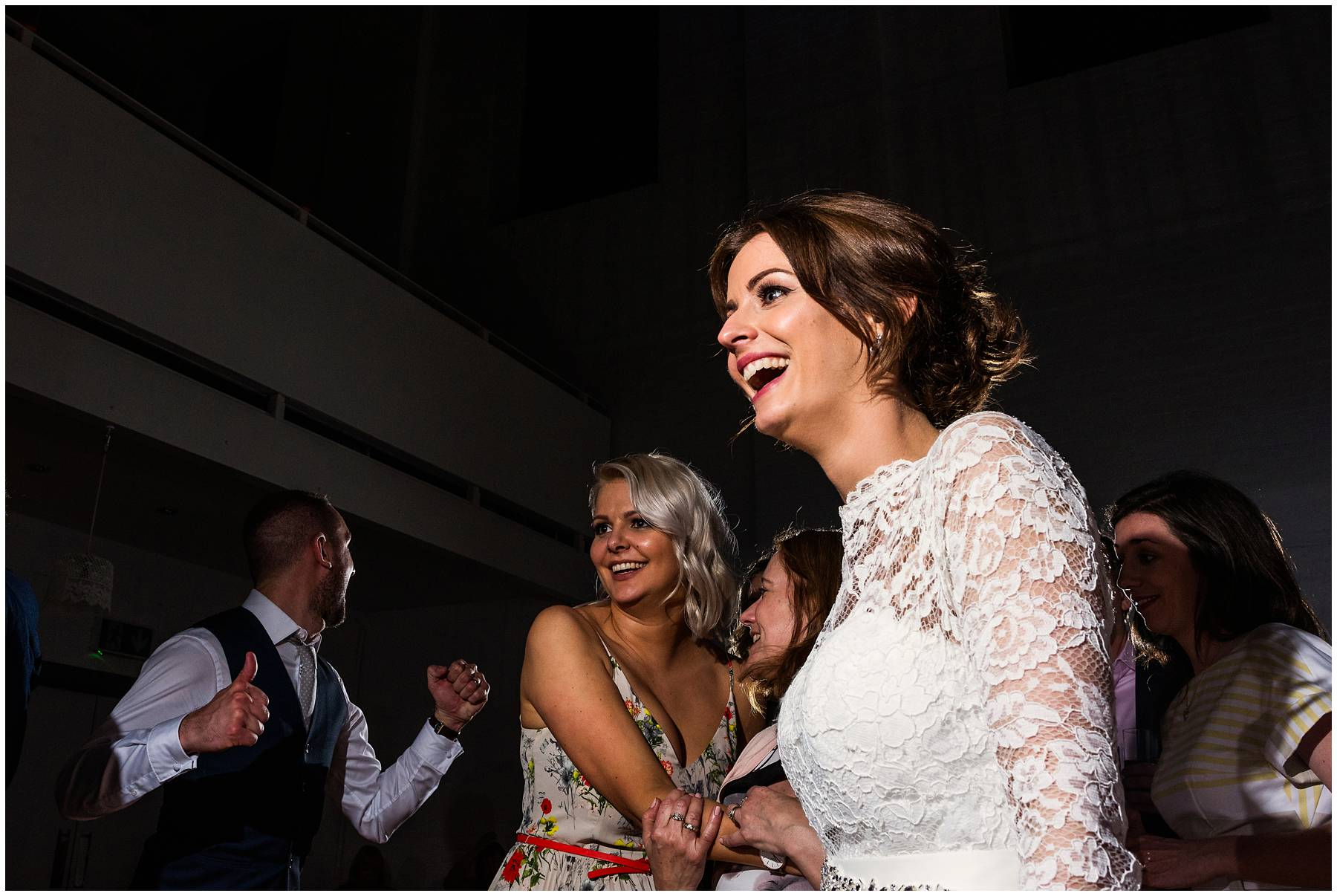 Bride laughing and dancing at The Winding House Wedding
