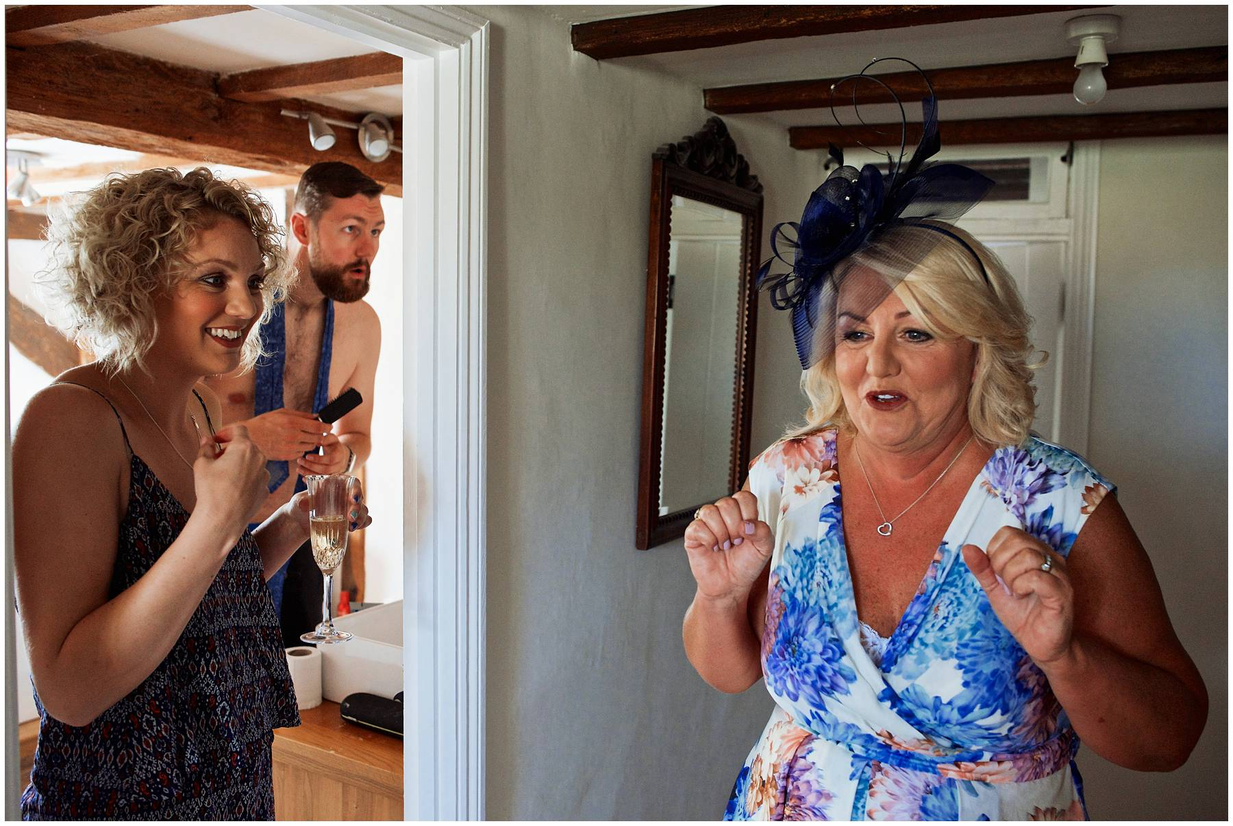 Excited mother of the bride at wedding in Coggeshall