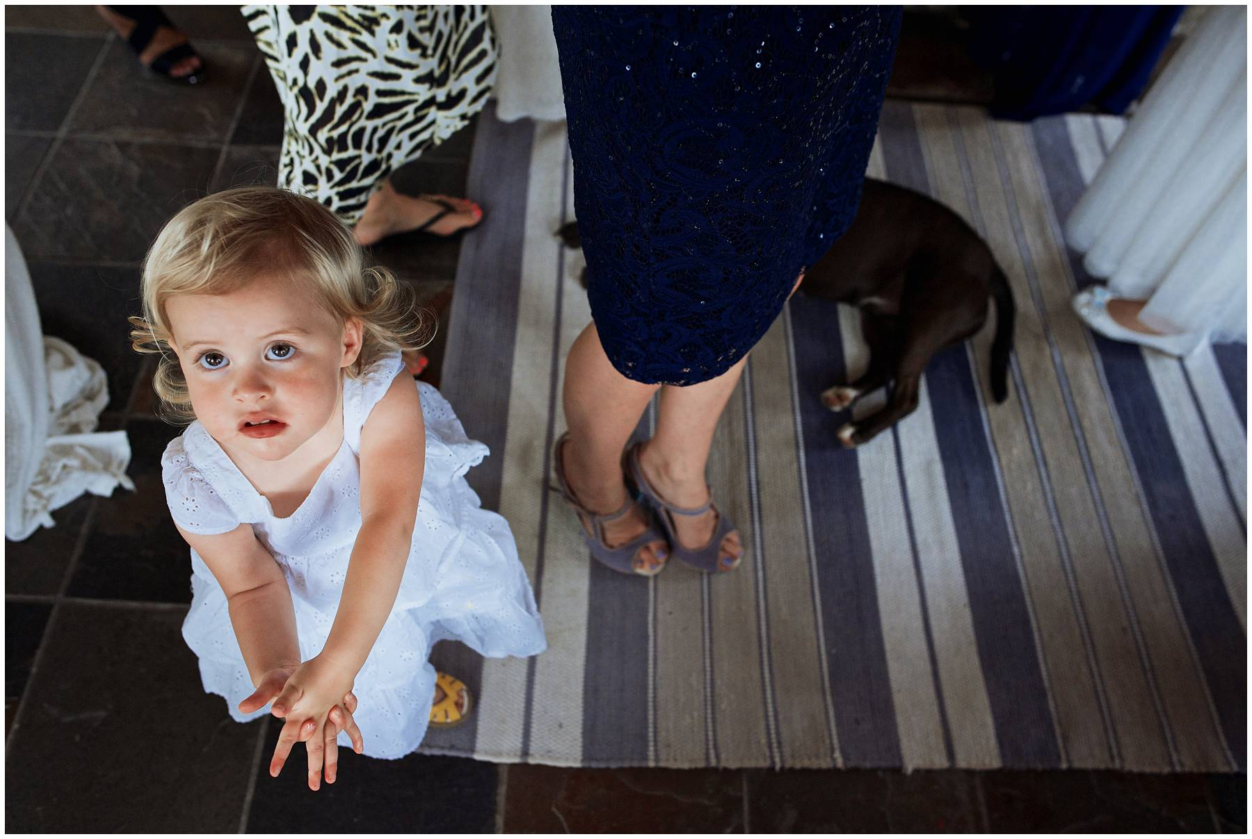 Cute flower girl at festival wedding