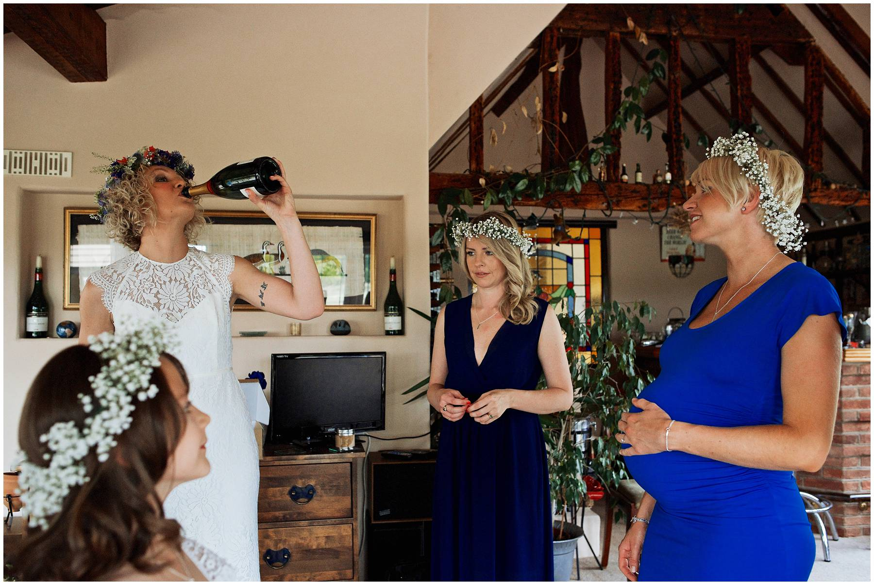 Festival bride drinking champagne from the bottle