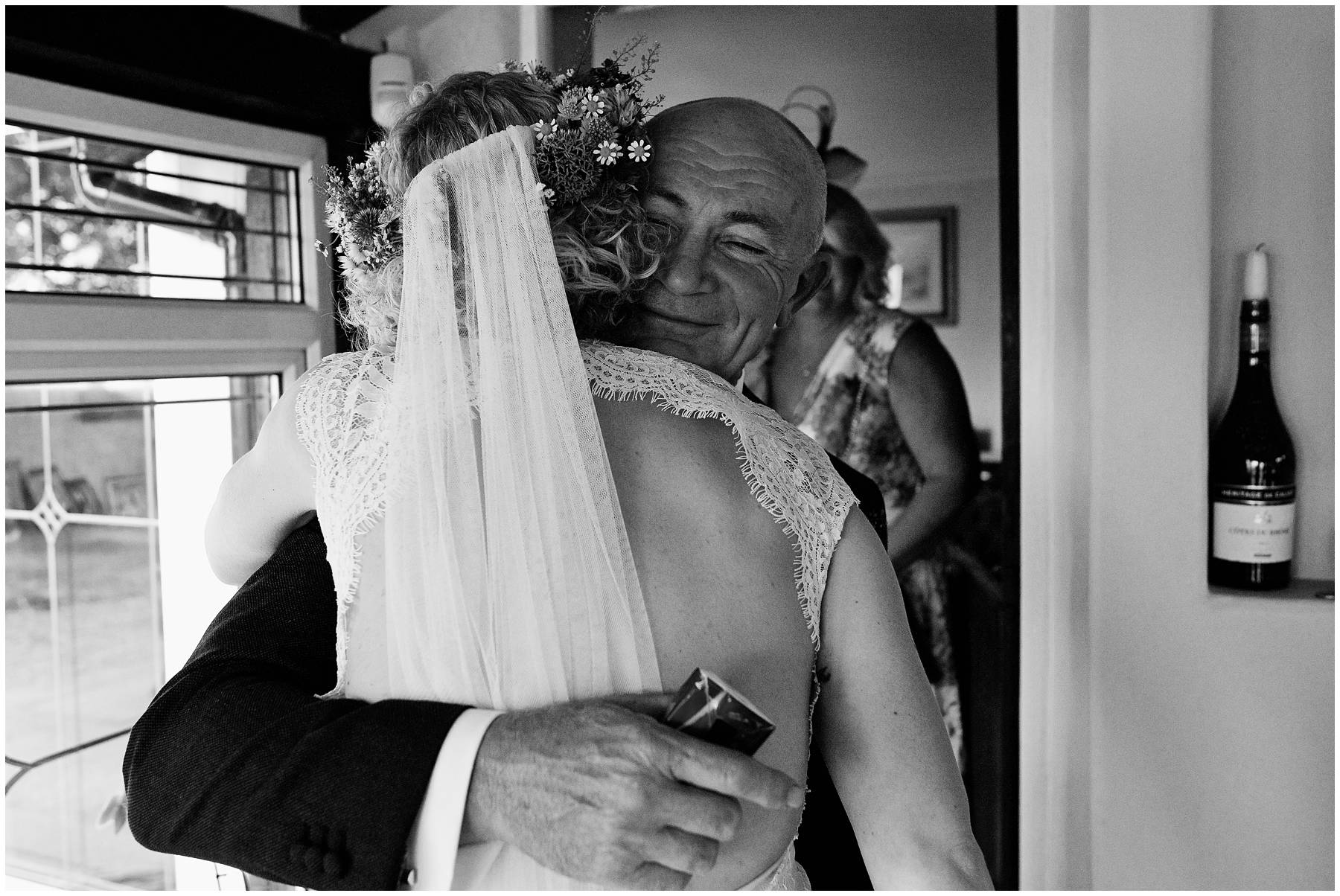 Dad hugging his daughter on her wedding day