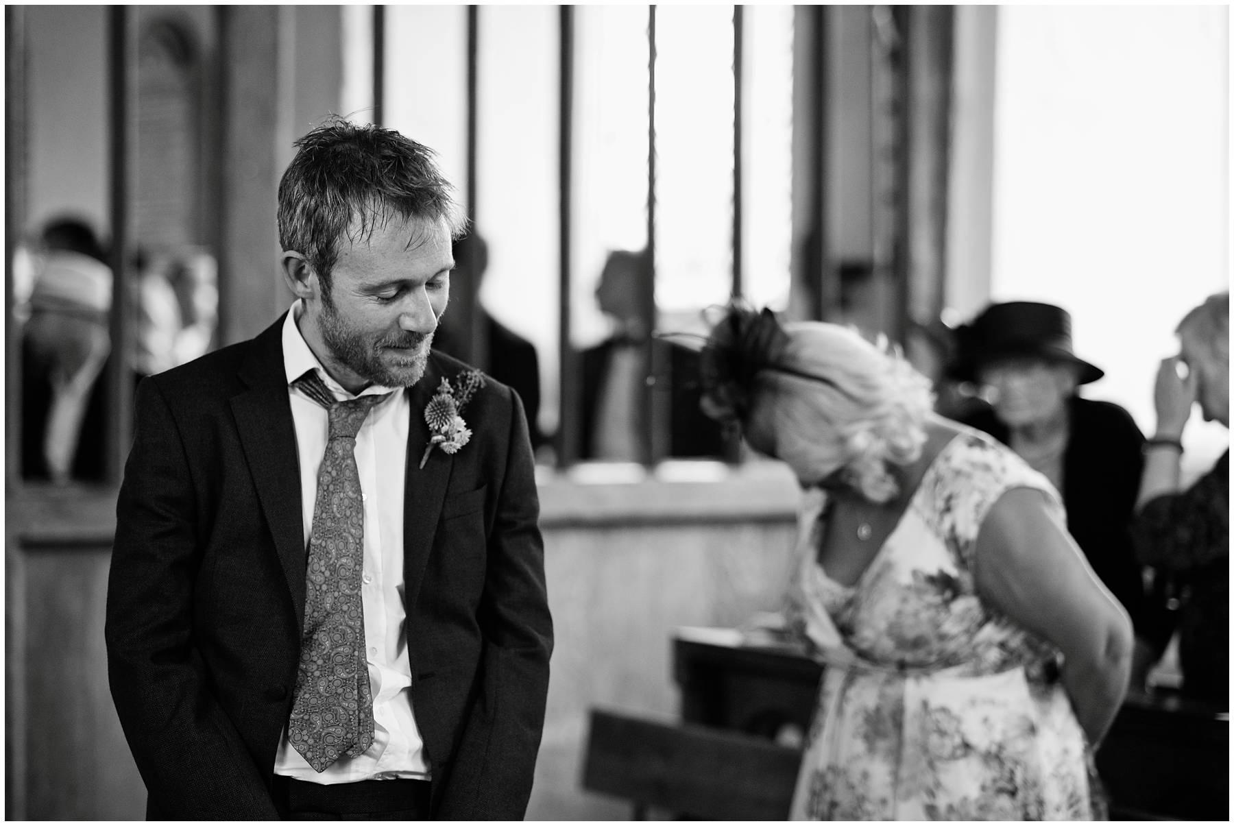 Nervous groom at church wedding in Essex