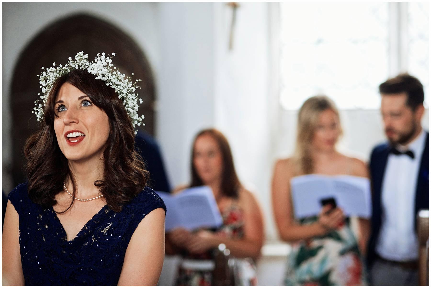 Bridesmaid singing at church wedding