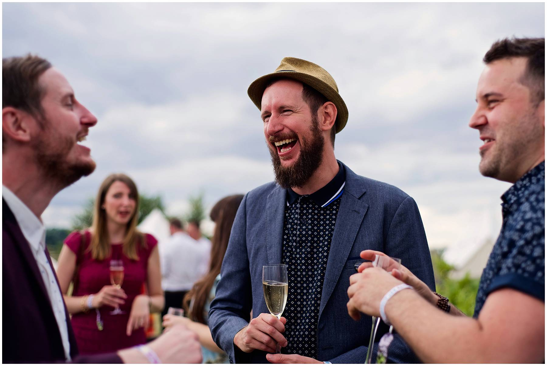 guests laughing at festival style wedding in Coggeshall