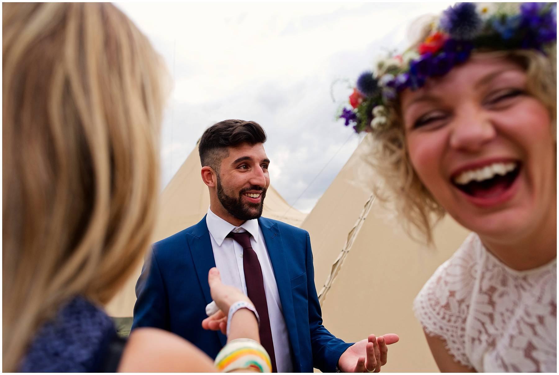 Festival bride laughing in Essex