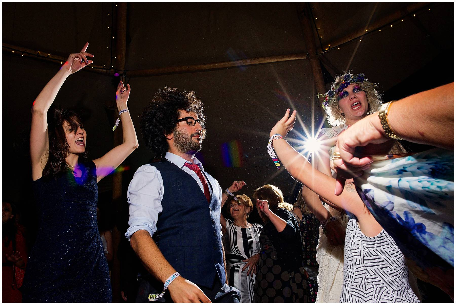 Guests dancing at tipi wedding in Essex