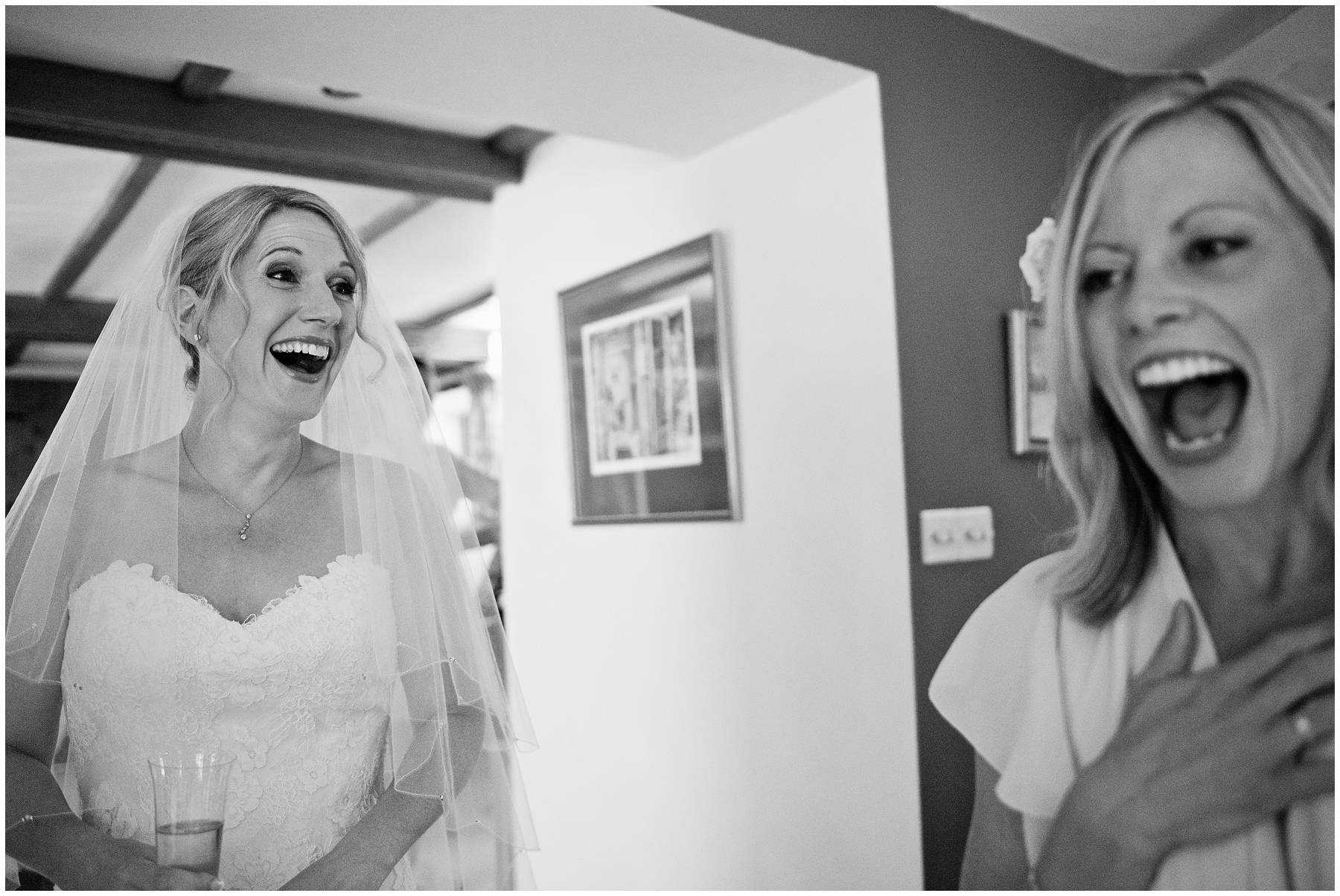 Bride and bridesmaid laughing at Taunton Wedding