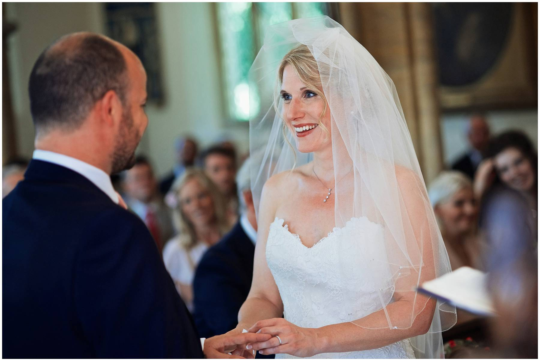 Bride and groom making vows at Taunton church wedding