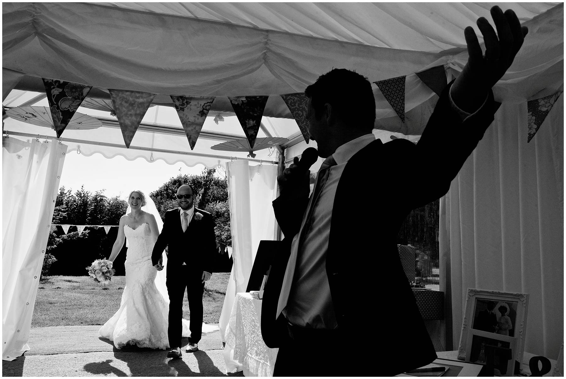 Bride and groom enter wedding marquee in Somerset