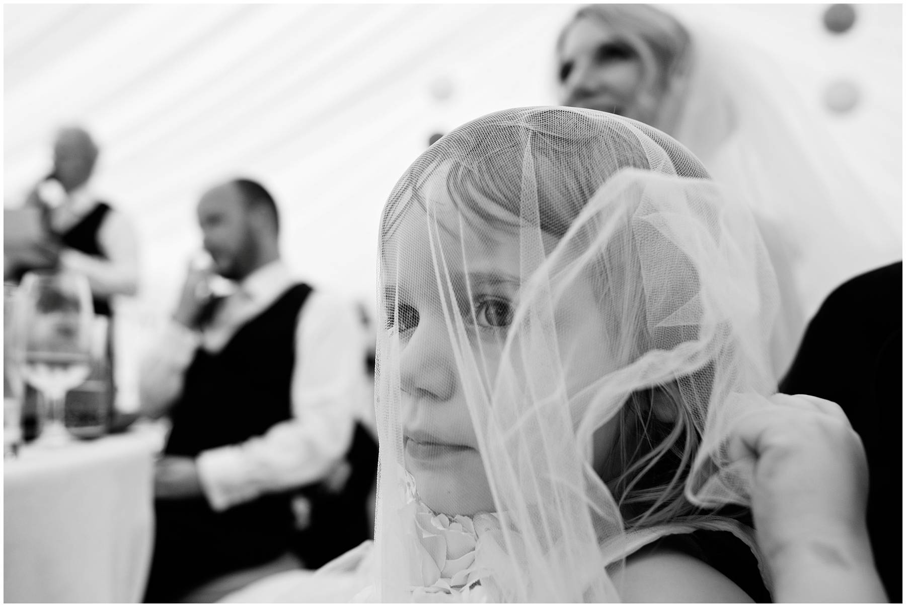 Flower girl under wedding veil