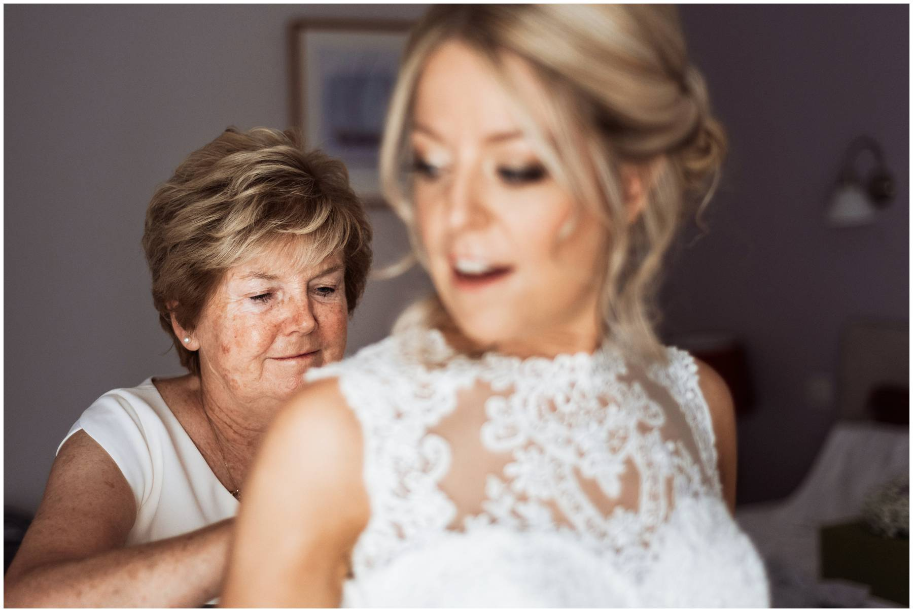 Bride's Mum doing up her dress