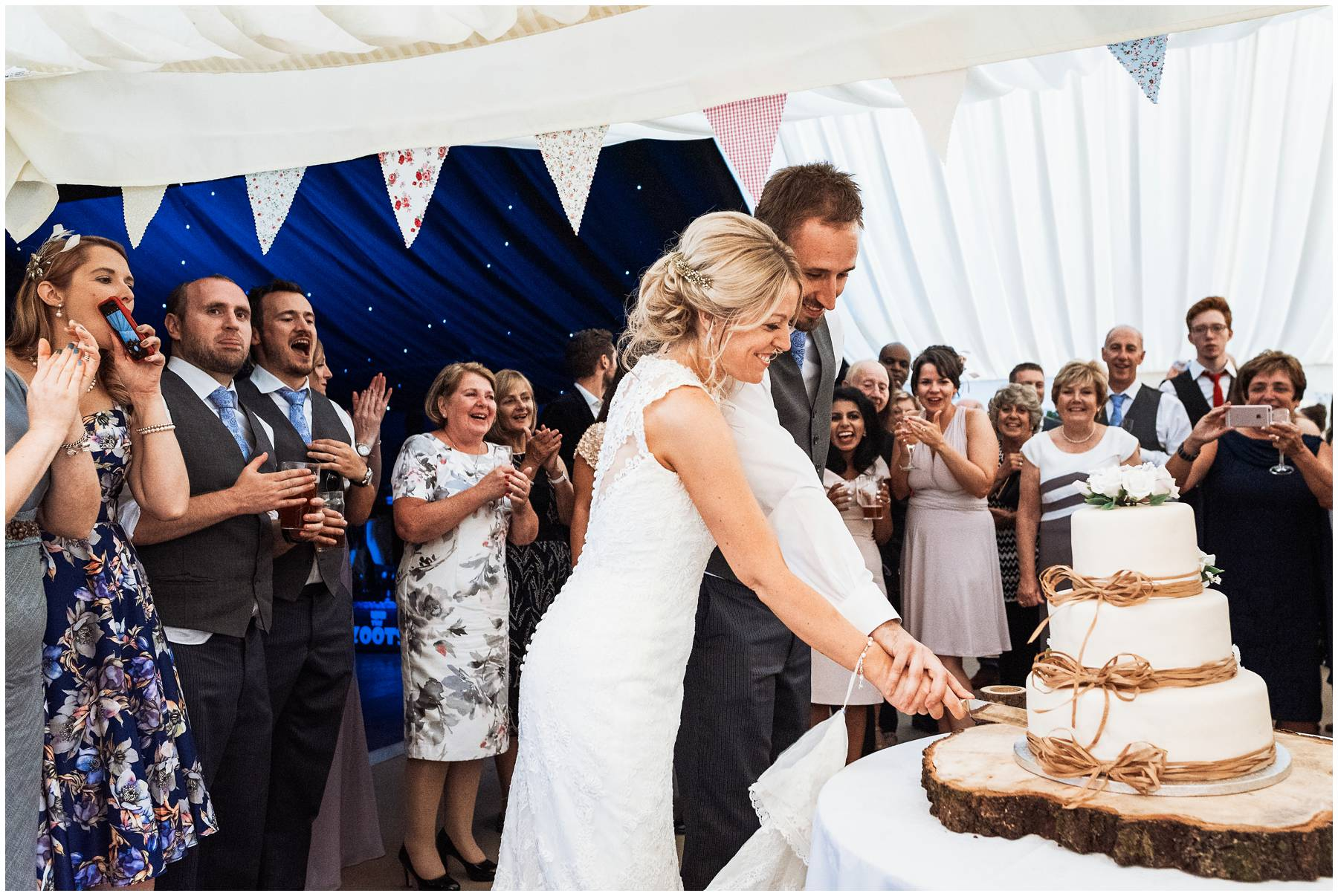 Cake cutting at Spetchley Park Wedding