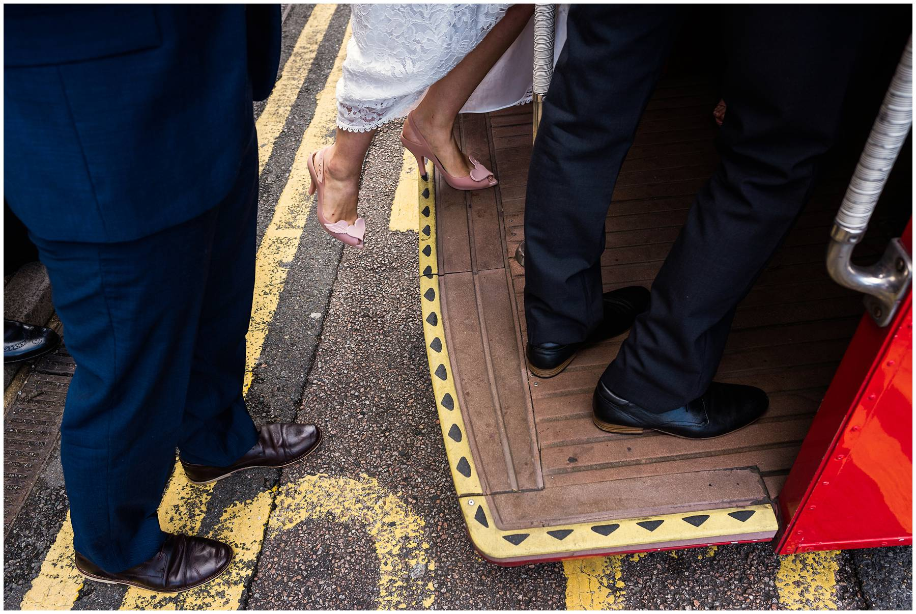 Bride getting onto bus in vivienne westwood wedding shoes