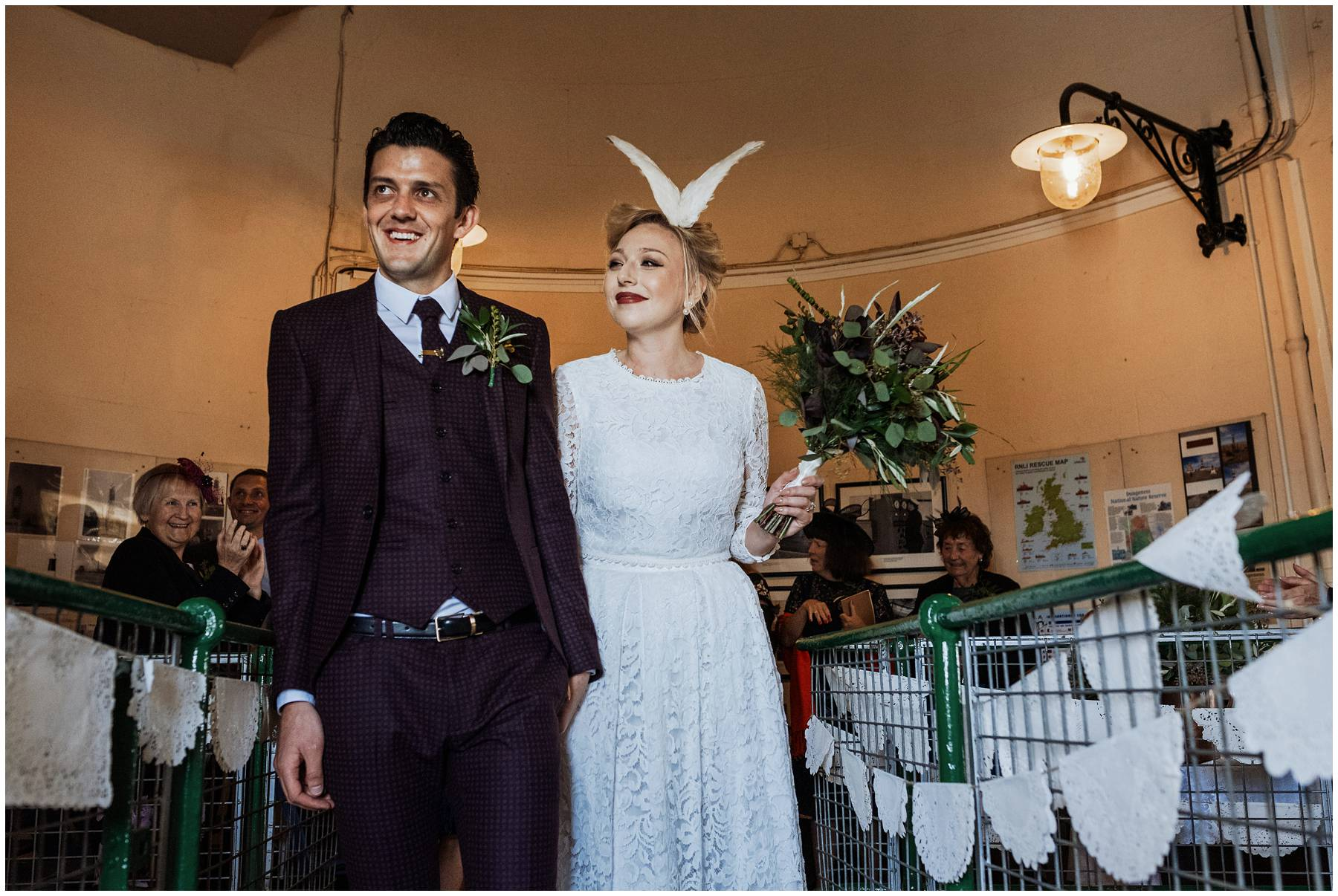 Bride wearing taxidermy dove wings
