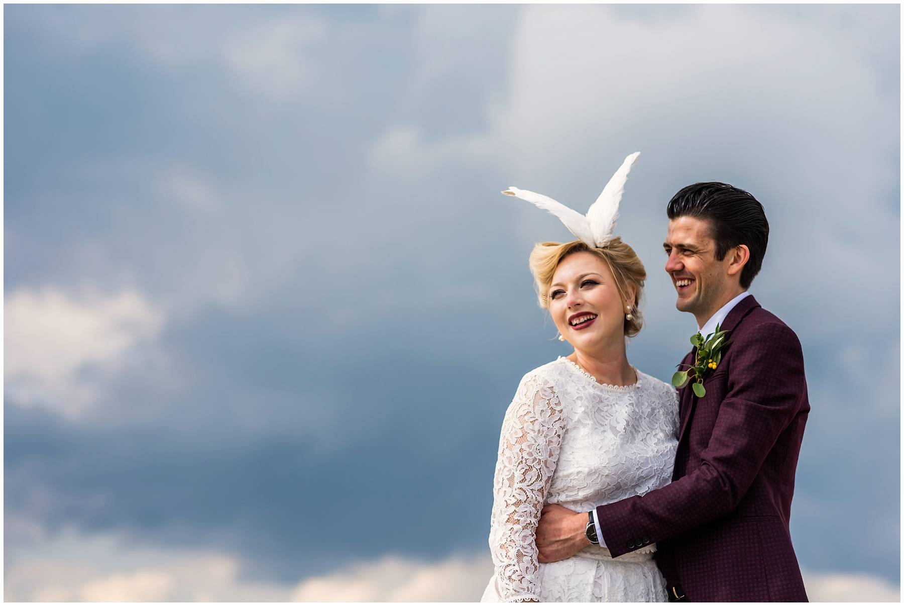 Bride wearing taxidermy dove wings headdress