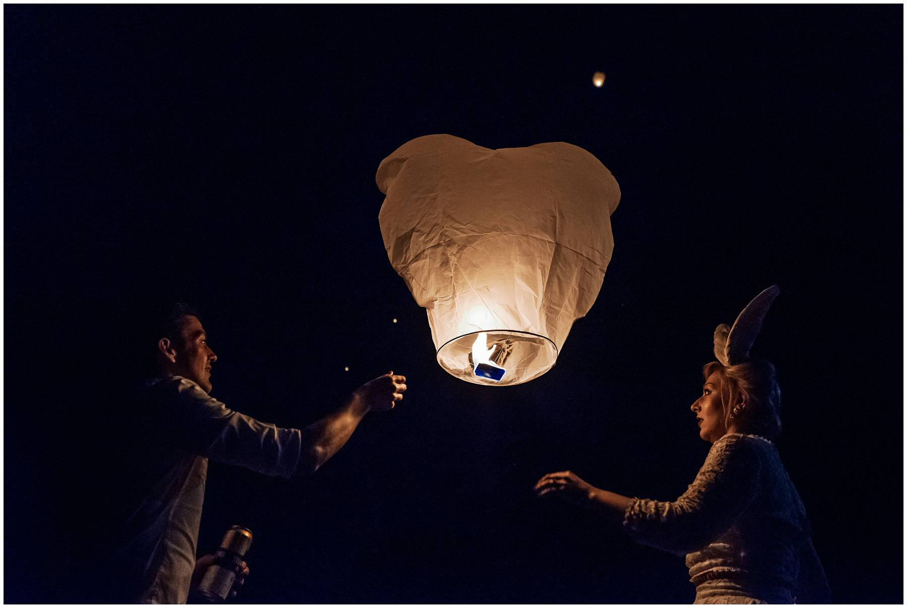 Bride and groom release Chinese lantern